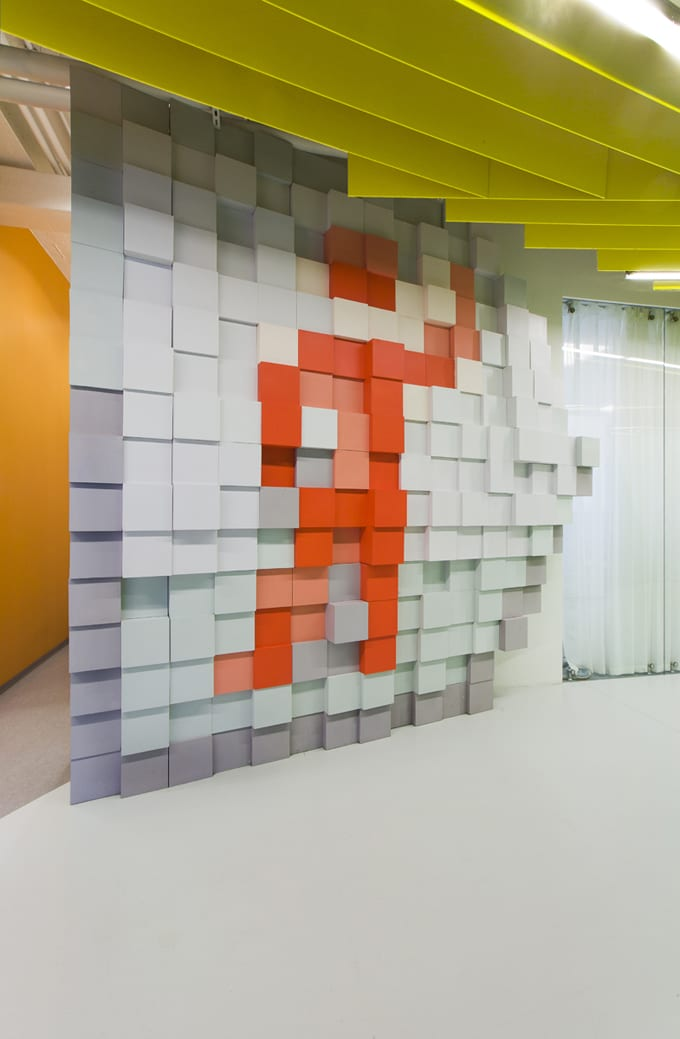 office feature wall. Good-office-design-yandex-business-interiors-pixel-man-wall-feature Office Feature Wall